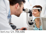 Купить «optician with tonometer and patient at eye clinic», фото № 21706686, снято 25 ноября 2015 г. (c) Syda Productions / Фотобанк Лори