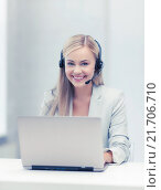 Купить «friendly female helpline operator with laptop», фото № 21706710, снято 30 марта 2013 г. (c) Syda Productions / Фотобанк Лори