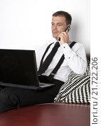 Купить «businessman sitting on couch with phone and labtop», фото № 21722206, снято 20 апреля 2018 г. (c) PantherMedia / Фотобанк Лори