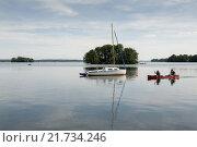 Купить «Ploen, Germany, paddlers on the Great Plön Lake», фото № 21734246, снято 2 августа 2015 г. (c) Caro Photoagency / Фотобанк Лори