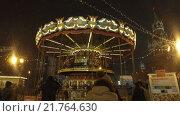 Купить «Люди на карусели, Красная площадь в Москве», видеоролик № 21764630, снято 15 января 2016 г. (c) Серёга / Фотобанк Лори