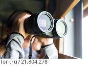 Купить «Woman use the binoculars for birdwatching», фото № 21804278, снято 25 марта 2019 г. (c) PantherMedia / Фотобанк Лори