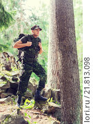 Купить «young soldier with backpack in forest», фото № 21813098, снято 14 августа 2014 г. (c) Syda Productions / Фотобанк Лори
