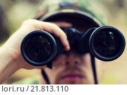 Купить «close up of soldier or hunter with binocular», фото № 21813110, снято 14 августа 2014 г. (c) Syda Productions / Фотобанк Лори
