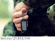 Купить «close up of young soldier in military uniform», фото № 21813114, снято 14 августа 2014 г. (c) Syda Productions / Фотобанк Лори