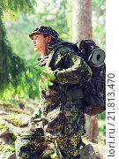 Купить «young soldier with backpack in forest», фото № 21813470, снято 14 августа 2014 г. (c) Syda Productions / Фотобанк Лори
