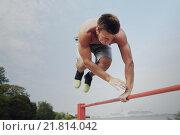 Купить «young man exercising on horizontal bar outdoors», фото № 21814042, снято 25 августа 2015 г. (c) Syda Productions / Фотобанк Лори