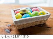 Купить «close up of colored easter eggs in basket», фото № 21814510, снято 27 января 2016 г. (c) Syda Productions / Фотобанк Лори