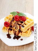 Купить «Waffles with chocolate and raspberries. Party dessert», фото № 21834278, снято 9 июля 2020 г. (c) BE&W Photo / Фотобанк Лори