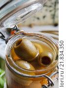 Купить «Green olives in glass jar. Mediterrean food», фото № 21834350, снято 6 июля 2020 г. (c) BE&W Photo / Фотобанк Лори