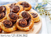 Купить «Palmier biscuits - french cookies made of puff pastry and chocolate», фото № 21834362, снято 21 августа 2018 г. (c) BE&W Photo / Фотобанк Лори