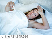 Купить «sick woman in bed taking her temperature», фото № 21849586, снято 2 сентября 2015 г. (c) Wavebreak Media / Фотобанк Лори