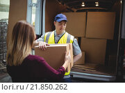 Купить «Delivery driver handing parcel to customer outside van», фото № 21850262, снято 17 октября 2015 г. (c) Wavebreak Media / Фотобанк Лори