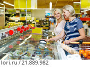 Купить «Female customers near display with frozen food», фото № 21889982, снято 19 сентября 2018 г. (c) Яков Филимонов / Фотобанк Лори