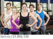 Купить «Fitness class with hands on hips», фото № 21892130, снято 27 сентября 2015 г. (c) Wavebreak Media / Фотобанк Лори
