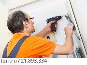 two kitchen installers at carpenter work. Стоковое фото, фотограф Дмитрий Калиновский / Фотобанк Лори
