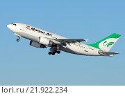Купить «Самолет Airbus A310 (бортовой EP-MMJ) авиакомпании Mahan Air вылетает из Внукова», эксклюзивное фото № 21922234, снято 18 февраля 2016 г. (c) Alexei Tavix / Фотобанк Лори