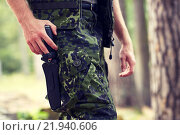 Купить «close up of soldier or hunter with knife in forest», фото № 21940606, снято 14 августа 2014 г. (c) Syda Productions / Фотобанк Лори
