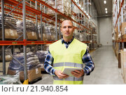 Купить «manual worker with tablet pc at warehouse», фото № 21940854, снято 9 декабря 2015 г. (c) Syda Productions / Фотобанк Лори
