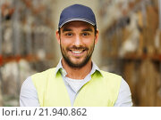 Купить «happy man in reflective safety vest at warehouse», фото № 21940862, снято 9 декабря 2015 г. (c) Syda Productions / Фотобанк Лори