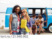 Купить «smiling hippie couple with friends over minivan», фото № 21940902, снято 27 августа 2015 г. (c) Syda Productions / Фотобанк Лори