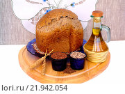 Купить «Хлеб из хлебопечки с семенами льна и подсолнечника», эксклюзивное фото № 21942054, снято 12 февраля 2016 г. (c) Blekcat / Фотобанк Лори