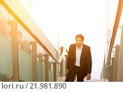 Купить «Indian businessman ascending steps.», фото № 21981890, снято 15 ноября 2018 г. (c) easy Fotostock / Фотобанк Лори