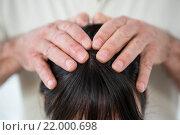 Купить «Close-up of woman receiving a head massage», фото № 22000698, снято 15 сентября 2015 г. (c) Wavebreak Media / Фотобанк Лори