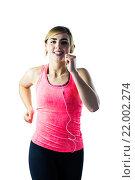 Купить «Woman jogging while listening to music», фото № 22002274, снято 7 октября 2015 г. (c) Wavebreak Media / Фотобанк Лори