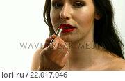 Купить «Woman putting red lipstick», видеоролик № 22017046, снято 2 июля 2020 г. (c) Wavebreak Media / Фотобанк Лори