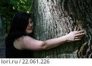 Купить «Young Woman hugging a Tree», фото № 22061226, снято 27 марта 2019 г. (c) PantherMedia / Фотобанк Лори