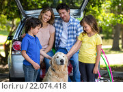 Купить «Smiling family in front of a car», фото № 22074418, снято 25 ноября 2015 г. (c) Wavebreak Media / Фотобанк Лори