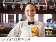 Купить «Barmaid holding a beer», фото № 22074554, снято 24 октября 2015 г. (c) Wavebreak Media / Фотобанк Лори