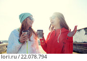 Купить «happy teenage girls with coffee cups on street», фото № 22078794, снято 19 марта 2015 г. (c) Syda Productions / Фотобанк Лори