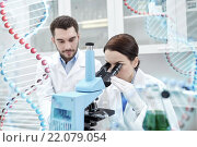 Купить «scientists with microscope making test in lab», фото № 22079054, снято 4 декабря 2014 г. (c) Syda Productions / Фотобанк Лори