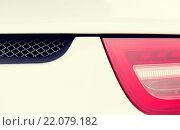 Купить «close up of car part with grille and headlight», фото № 22079182, снято 28 марта 2015 г. (c) Syda Productions / Фотобанк Лори