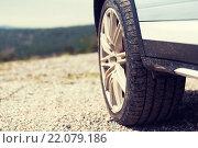 Купить «close up of dirty car wheel on cliff», фото № 22079186, снято 28 марта 2015 г. (c) Syda Productions / Фотобанк Лори