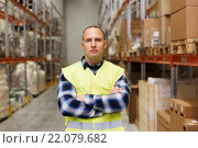 Купить «man in reflective safety vest at warehouse», фото № 22079682, снято 9 декабря 2015 г. (c) Syda Productions / Фотобанк Лори