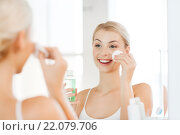 Купить «young woman with lotion washing face at bathroom», фото № 22079706, снято 13 февраля 2016 г. (c) Syda Productions / Фотобанк Лори