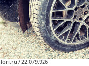 Купить «close up of dirty car wheel on ground», фото № 22079926, снято 28 марта 2015 г. (c) Syda Productions / Фотобанк Лори