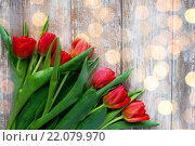 Купить «close up of red tulips on wooden background», фото № 22079970, снято 3 марта 2015 г. (c) Syda Productions / Фотобанк Лори