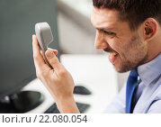 Купить «angry businessman calling on phone in office», фото № 22080054, снято 15 марта 2014 г. (c) Syda Productions / Фотобанк Лори