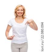 Купить «smiling woman in white t-shirt pointing to herself», фото № 22080094, снято 27 ноября 2015 г. (c) Syda Productions / Фотобанк Лори