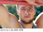 Купить «young man exercising on horizontal bar outdoors», фото № 22080398, снято 25 августа 2015 г. (c) Syda Productions / Фотобанк Лори