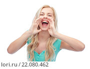 young woman or teenage girl shouting. Стоковое фото, фотограф Syda Productions / Фотобанк Лори