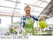Купить «happy woman with watering can in greenhouse», фото № 22080762, снято 25 февраля 2015 г. (c) Syda Productions / Фотобанк Лори
