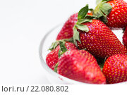 Купить «close up of ripe red strawberries over white», фото № 22080802, снято 26 апреля 2015 г. (c) Syda Productions / Фотобанк Лори