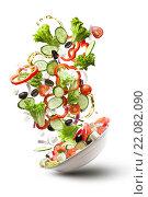 Купить «Летающий салат из свежих овощей на белом фоне», фото № 22082090, снято 10 февраля 2016 г. (c) Ярослав Данильченко / Фотобанк Лори