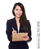 Купить «Young Businesswoman take note on clipboard», фото № 22151810, снято 21 октября 2019 г. (c) PantherMedia / Фотобанк Лори