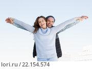 Купить «Happy couple standing with arms outstretched», фото № 22154574, снято 7 октября 2015 г. (c) Wavebreak Media / Фотобанк Лори